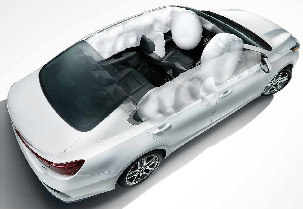 Airbags Inflating in a White 2019 Kia Forte