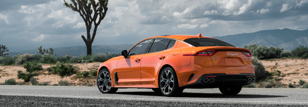 Orange 2020 Kia Special Edition Stinger GTS with a Joshua tree in the background