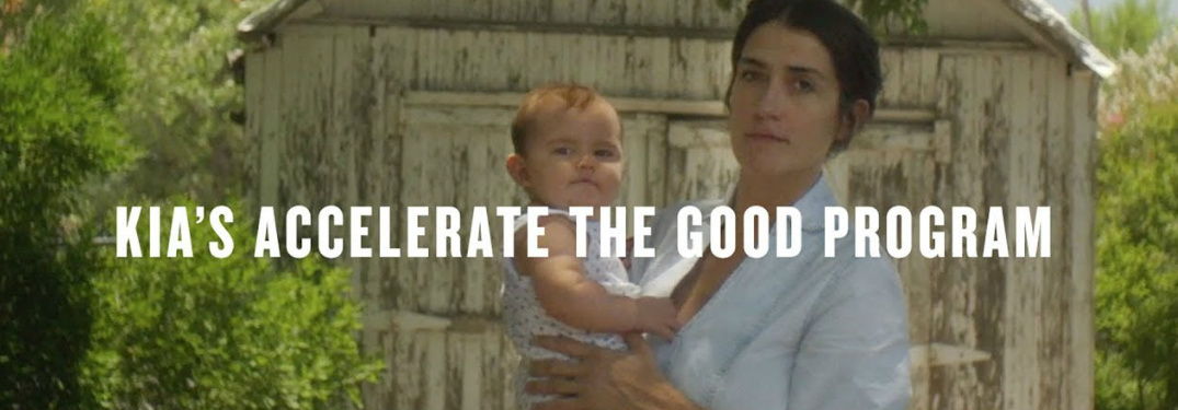 Kia's Accelerate the Good Program title and a woman holding a baby