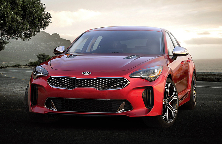 Driver's side front angle view of red 2020 Kia Stinger