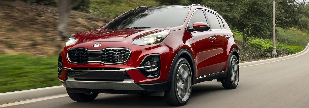 Driver's side front angle view of red 2021 Kia Sportage