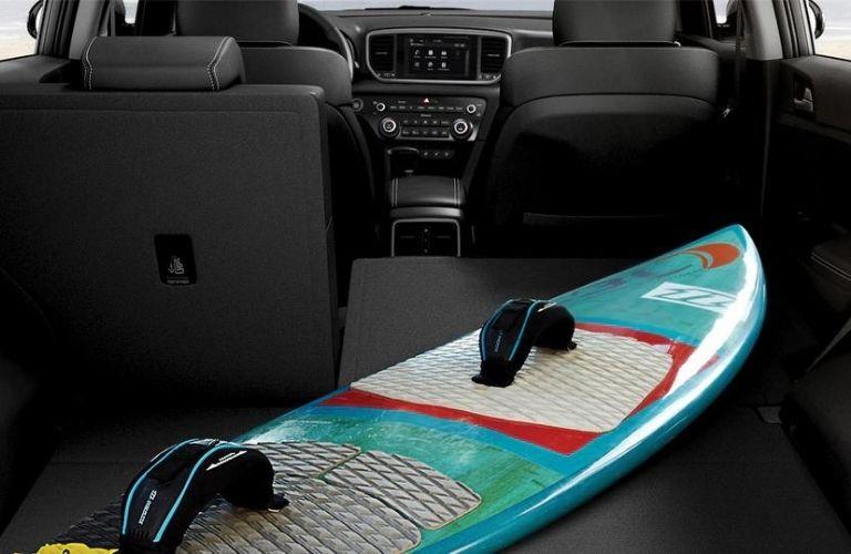 2022 Kia Sportage interior cargo space with paddle board