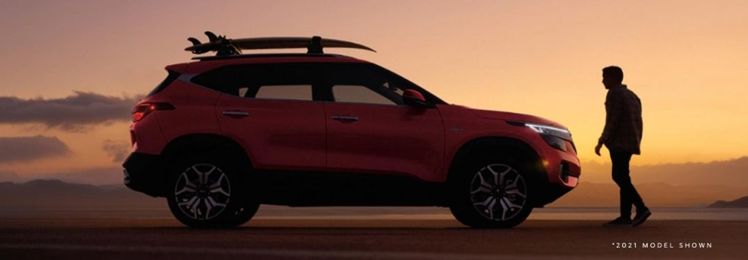 2022 Kia Seltos exterior passenger side with person standing in front