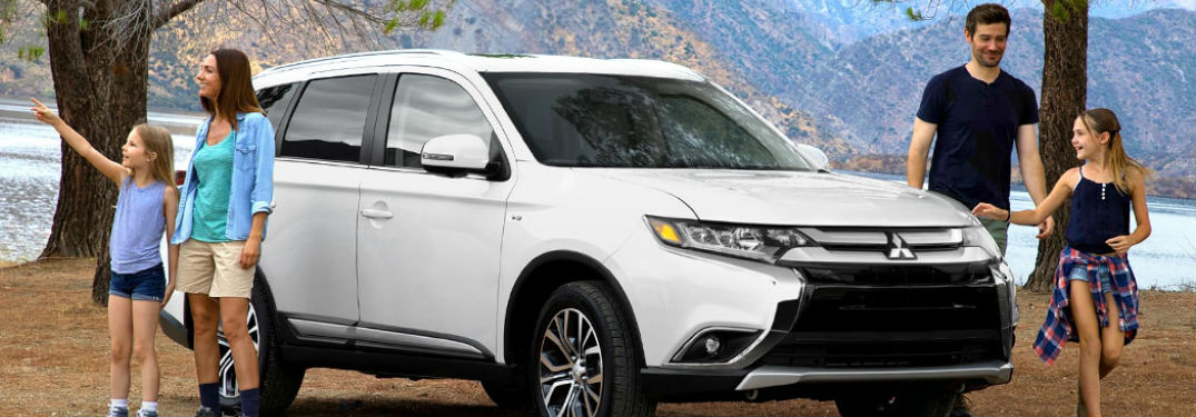 2018 Mitsubishi Outlander parked with family exiting vehilce