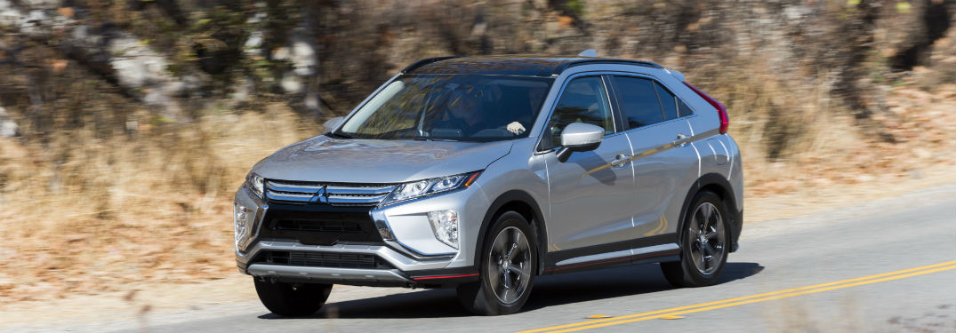 2018 Mitsubishi Eclipse Cross exterior front fascia and drivers side going fast on road