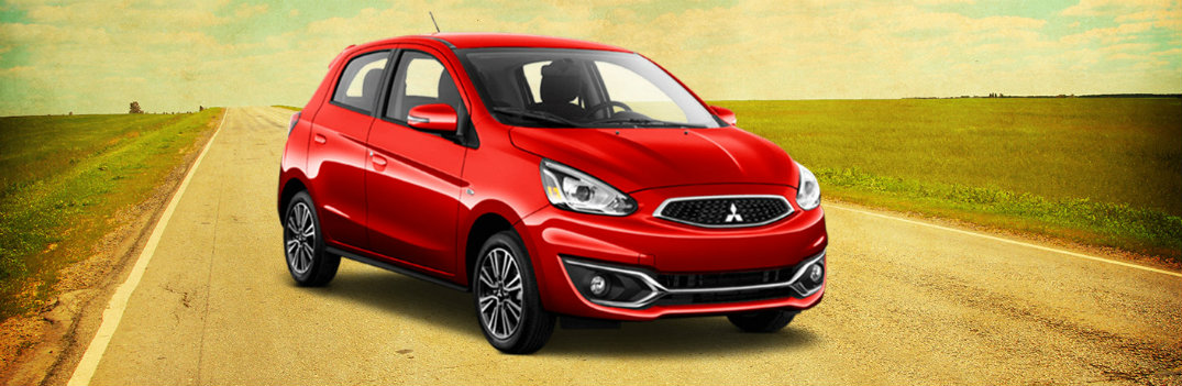 2018 Mitsubishi Mirage red sitting on sunny country road