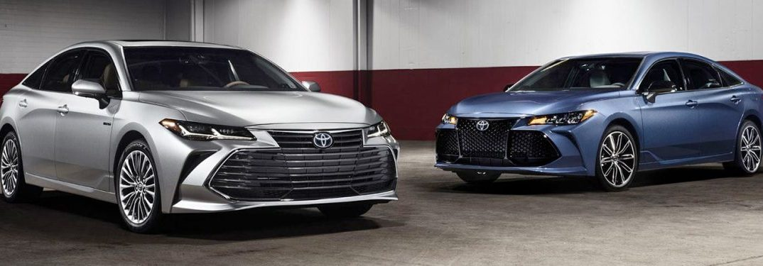 two 2019 Toyota Avalon models parked in a parking garage next to each other
