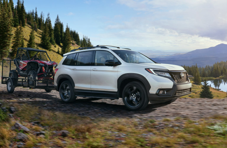 2019 Honda Passport driving off road at the foot of a mountain