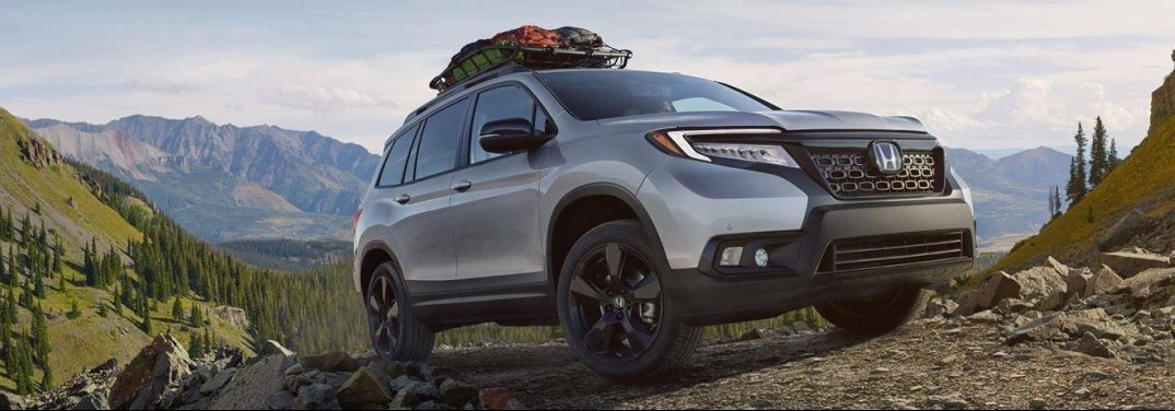 2019 Honda Passport driving off road in some mountains