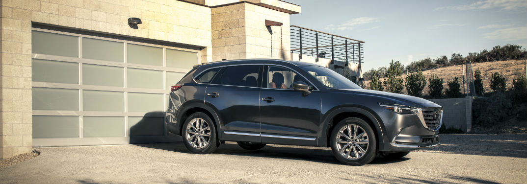 2017 mazda cx-9 next to a garage