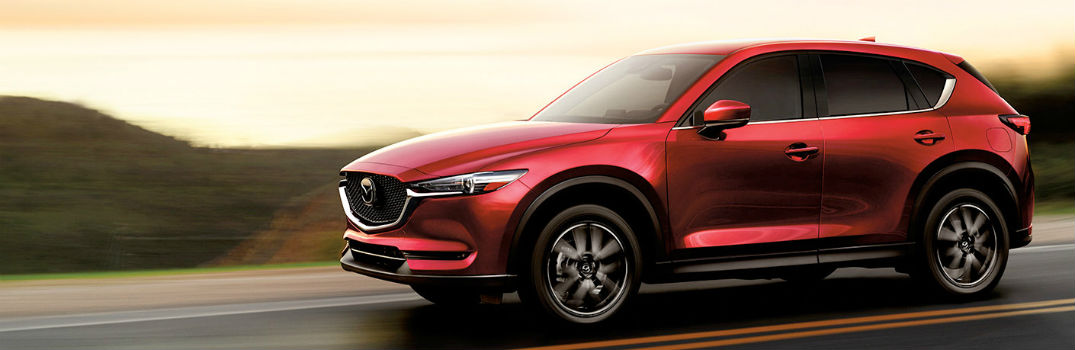 red 2018 CX-5 on the road