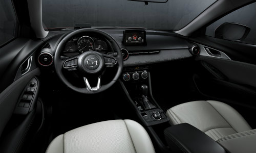 2019 Mazda CX-3 interior shot of front seating, steering wheel, and dashboard