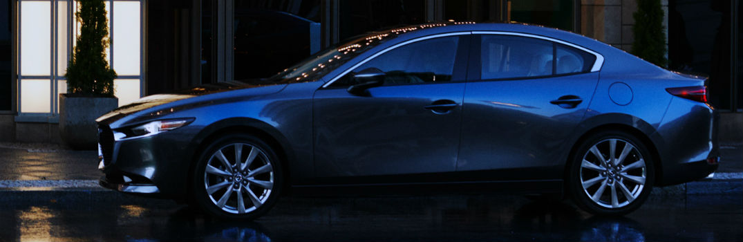 Mazda3 exterior profile in a dark city night.