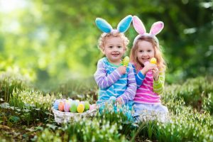 two little girls hunting for Easter eggs