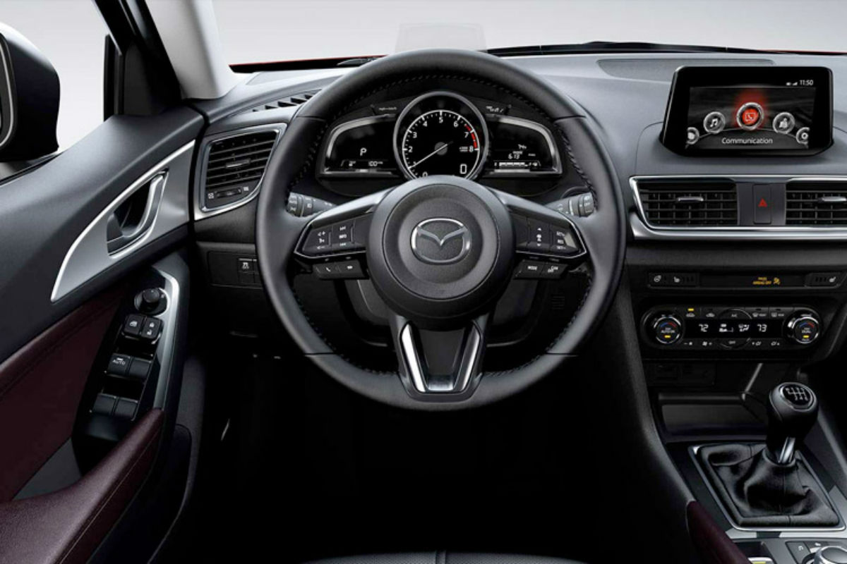 Steering wheel mounted controls and driver information cluster of the 2017 Mazda3