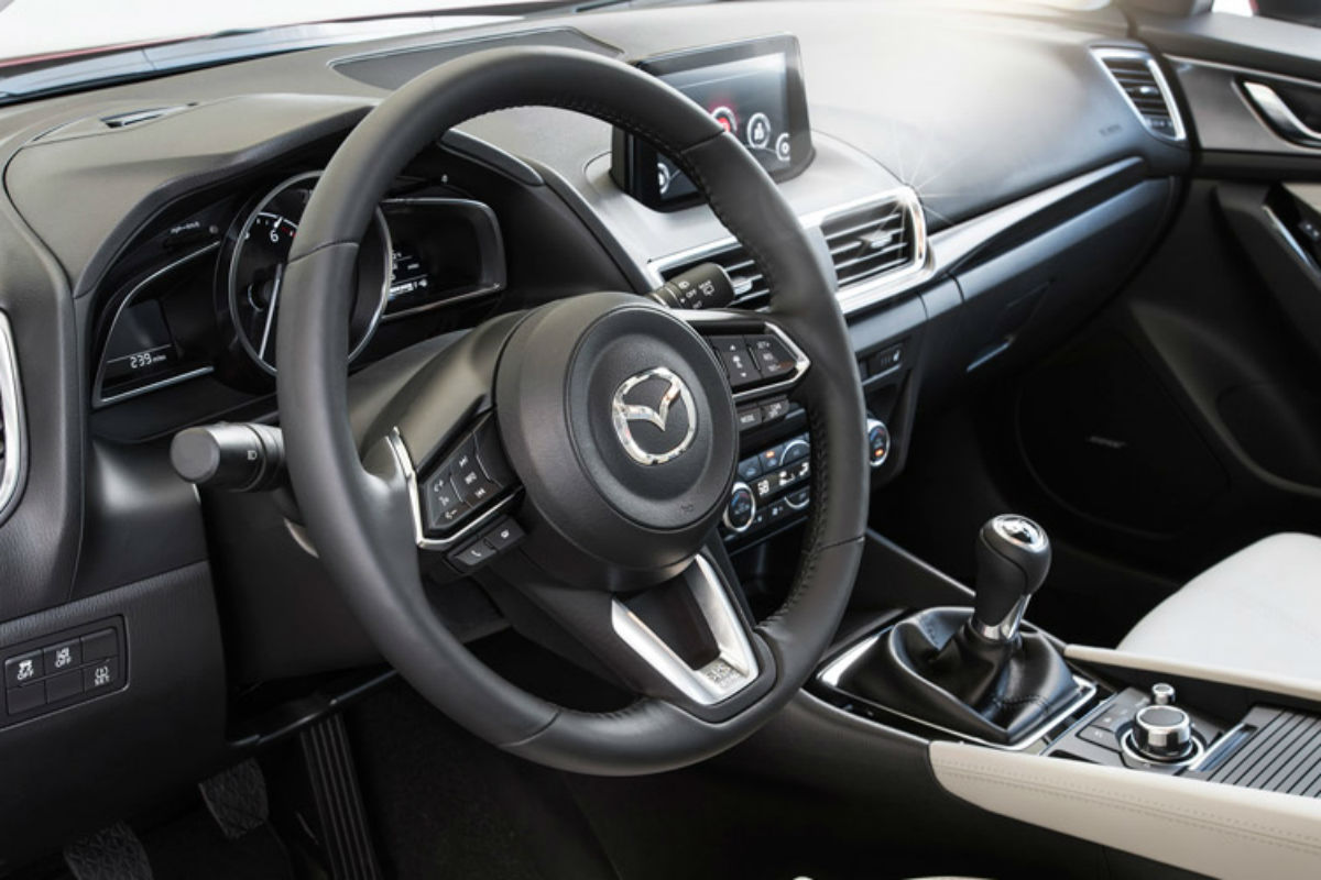 Side view of the driver's cockpit of the 2017 Mazda3