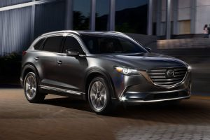 Front passenger side exterior view of a gray 2019 Mazda CX-9