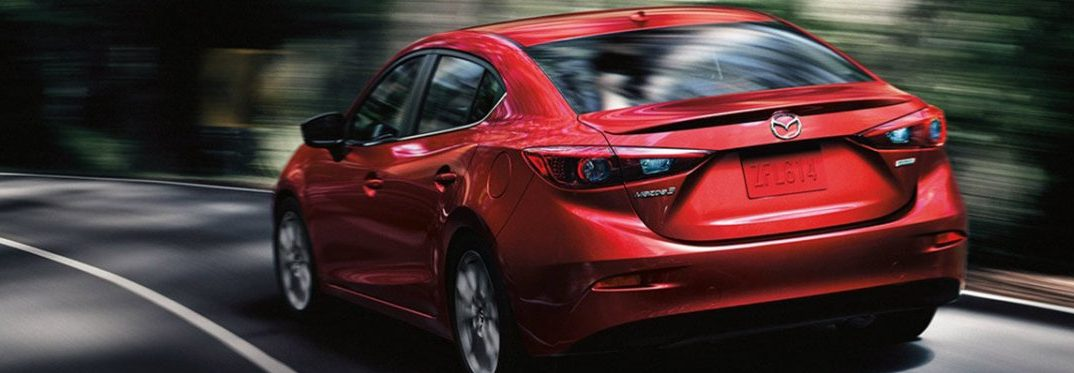 Red 2018 Mazda3 zooms around a corner on a highway. Does it have Apple CarPlay and Android Auto inside?