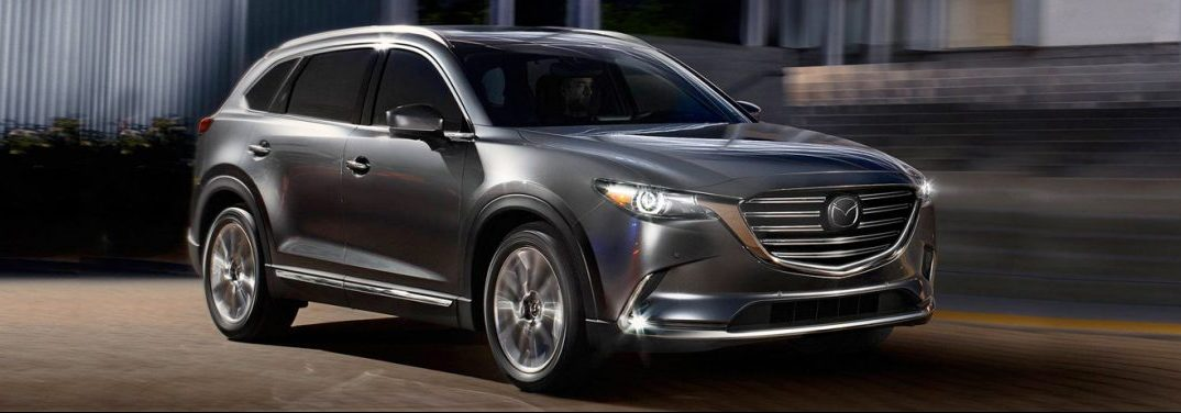 Silver 2019 Mazda CX-9 parked in a garage.