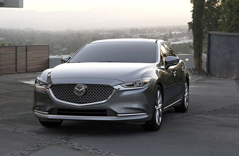Silver 2019 Mazda6 parked with a foggy view stretching out behind.