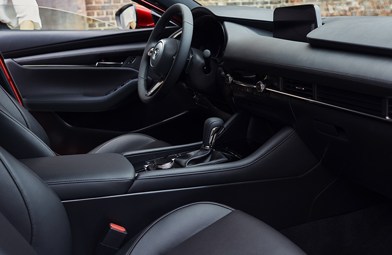 Interior front of a Mazda3, where driver and passenger will feel more safe thanks to standard safety features for 2020.