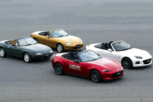 all 4 MX-5 Mazda Miata generations parked in diamond formation