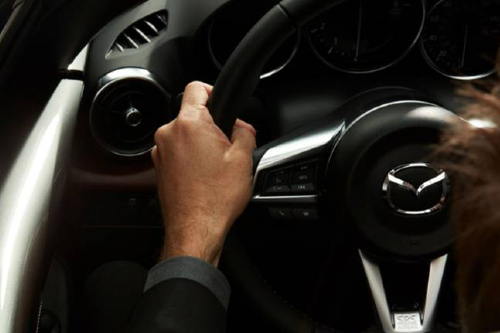 2019 Mazda man gripping steering wheel