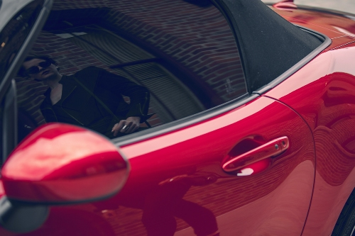 2019 MX-5 Miata with passerby reflected in the window and paint