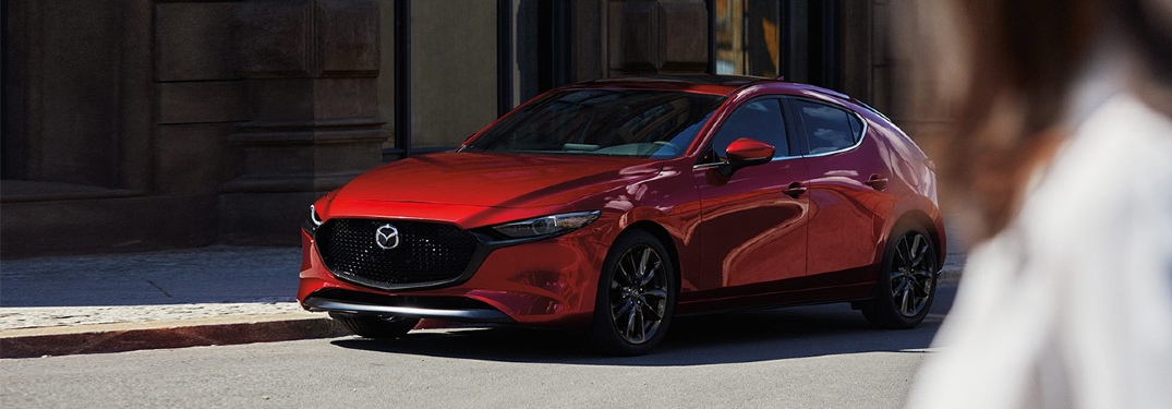 2020 Mazda3 hatchback parked on city street