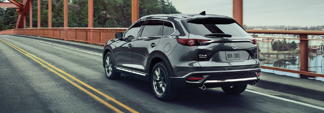 2020 CX-9 driving across a bridge