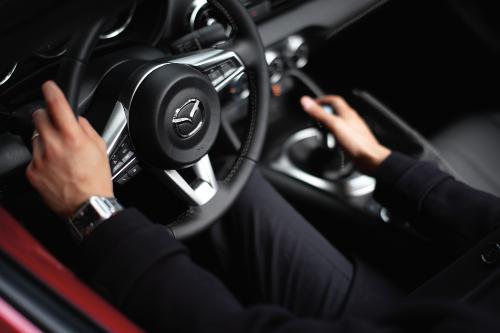 driver shifting a 2020 Miata