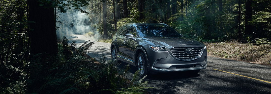 2021 CX-9 driving on wooded road
