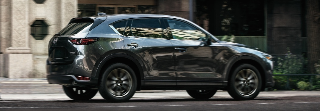 2021 CX-5 driving down city street