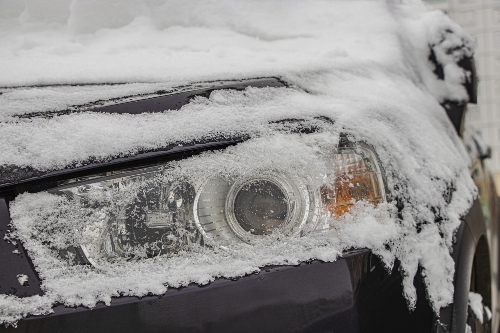 close up on snow covered headlight