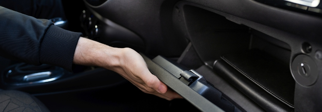 How did the glove compartment get its name?