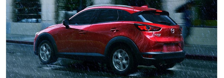 2021 Mazda CX-3 driving away in the rain
