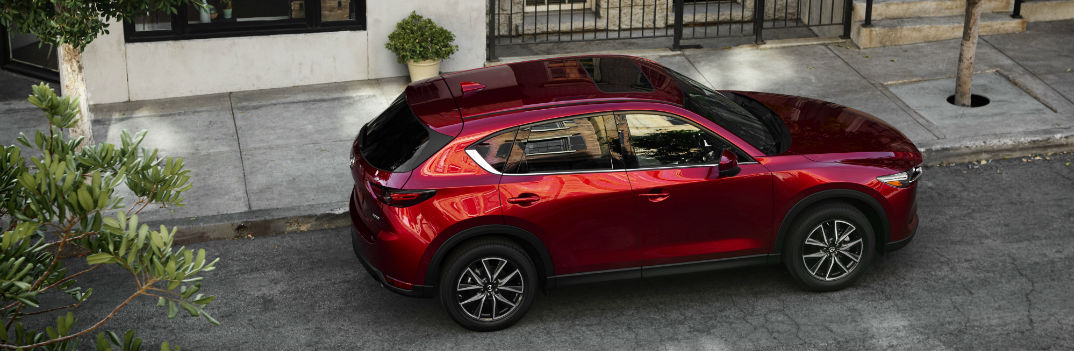 2017 mazda cx-5 parked on a street curb