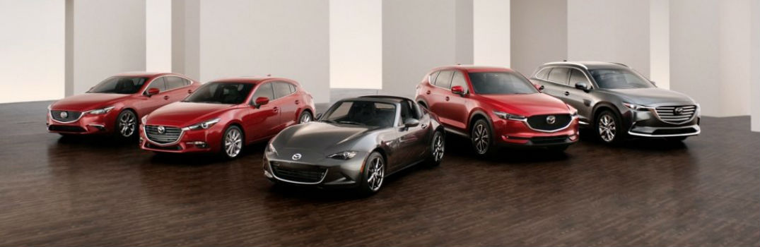five Mazda models lined up in a showroom