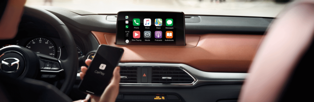 2019 Mazda CX-6 front interior with driver using CarPlay