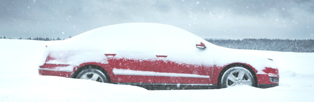 generic vehicle covered in snow