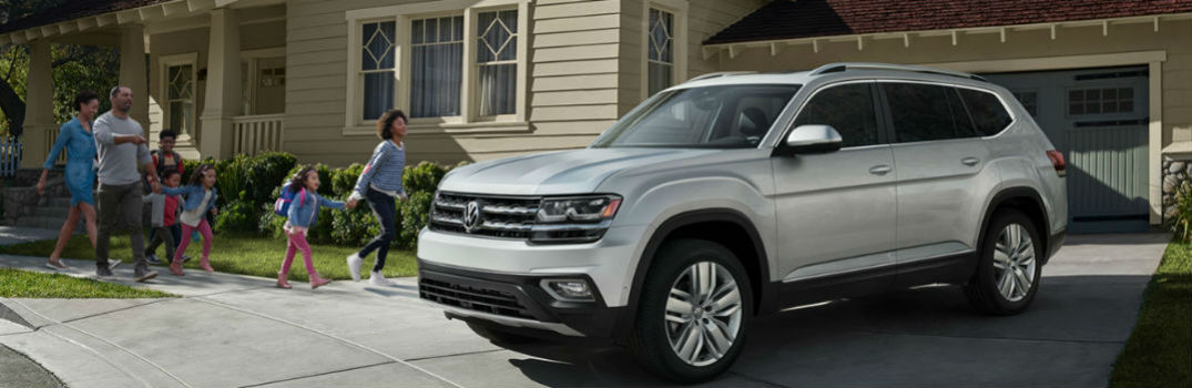 2019 VW Atlas in driveway with family entering