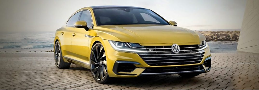 Yellow 2019 Volkswagen Arteon parked on a beach.
