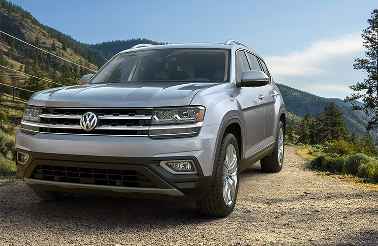 A silver 2019 Volkswagen Atlas sits ruggedly offroad, looking calm and confident as the king of its surroundings.
