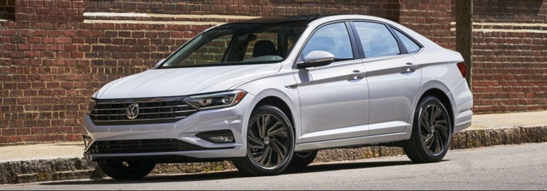 White 2019 Volkswagen Jetta parked by curb