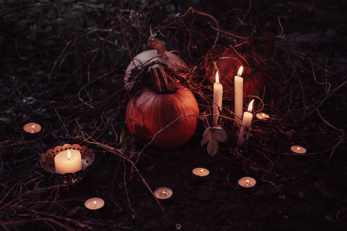Pumpkins and candles in a field