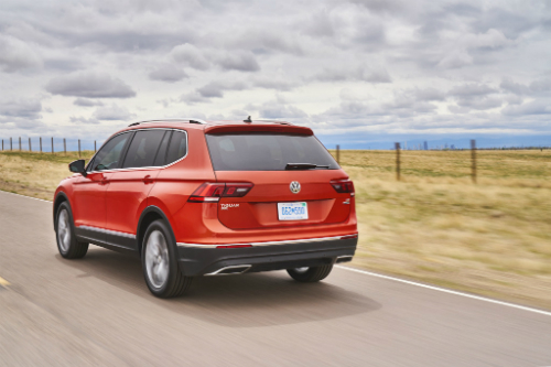 2020 Tiguan driving on road next to field and body of water