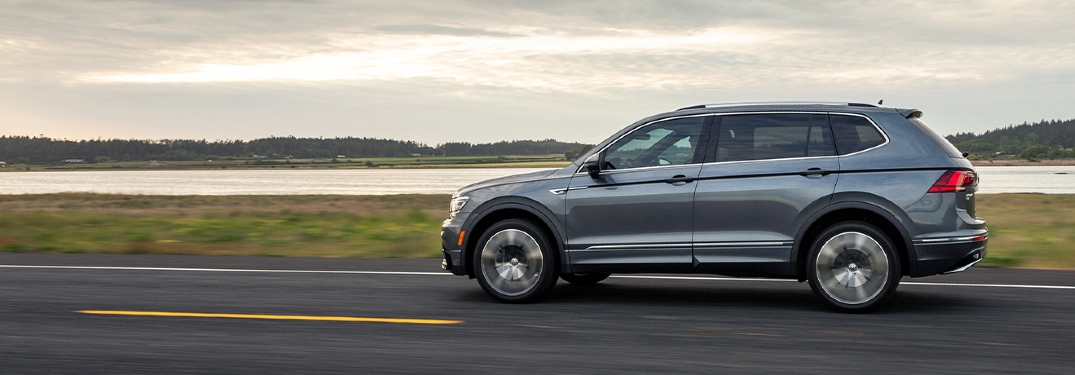 2020 VW Tiguan driving down a highway next to water
