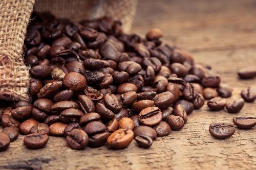 burlap bag of roasted coffee beans