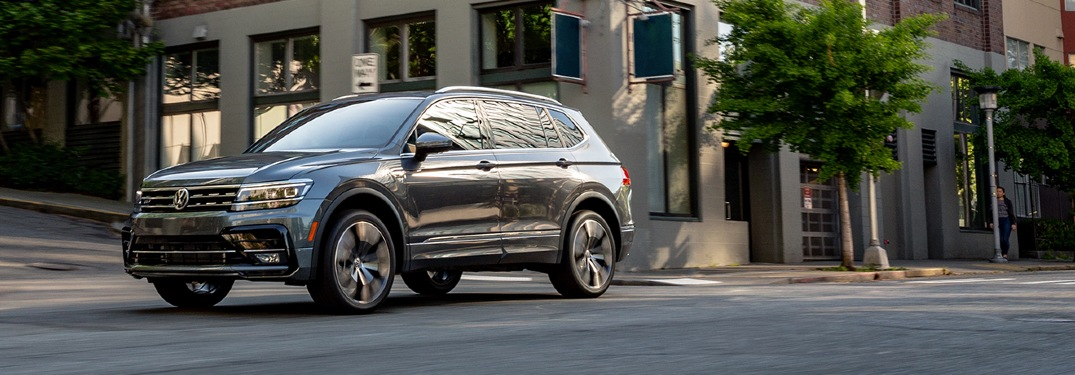 2020 Tiguan driving down a city street