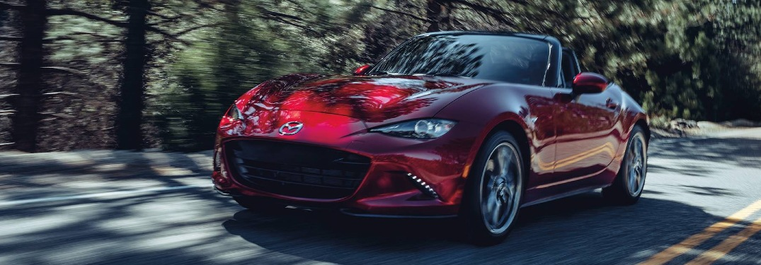 2020 Miata driving down a wooded road